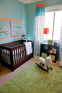 1 - A modern room with two colour combinations that have been used very innovatively in few places for a cartoon loving toddler boy .The wooden cot and shelf have a rich brown color.The curtain complements the walls and a green rug is added along with some more additional accessories of the same colours which give a refreshing feel to the look of the room.The colors in the room,lend a very calm look.The toddler's room has a wooden rocking horse which I like a lot.
