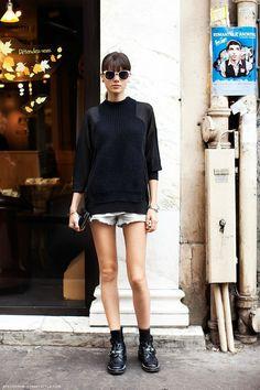 Black sweater, cut-offs, black booties