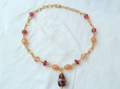 Pink and gold beaded necklace £17.00