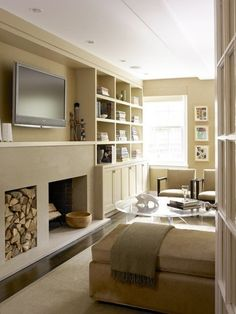 Small narrow sitting area w fireplace & shelving...a great idea for a dormer space.