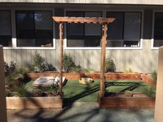 Preschool Playground. This area has artificial turf with two large dog beds from Costco. The area is used for reading books, laying down, playing with dinosaurs, yoga ect. This area can be used for relaxing or playing in small groups.