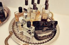 Trays are great options for storing and displaying perfume bottles and other vanity items.