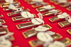 Jesi Haack made their escort cards with harmonicas and guests received posters as wedding favors.