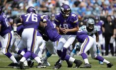 Minnesota Vikings quarterback Sam Bradford (8) runs a play against the Carolina Panthers during their game at Bank of America Stadium on Sunday, September 25, 2016. The Vikings won, 22-10.