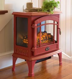 Love this heater! Looks like a stove, but just plugs in. No wood to chop, stays cool on top!