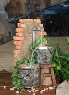 Bricks,mortar,buckets,spigot,pump = DIY