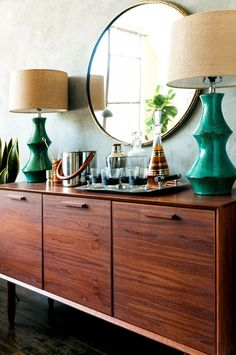 Green vintage lamps on bar/console table with round mirror- mid century modern Mid Century Modern Living Room, Mid Century Dining, Mid Century Modern Furniture, Midcentury Modern, Mid Century Buffet, Mid Century Modern Lamps, Mid Century Bar Cabinet, Mid Century Credenza, Mid Century Dresser