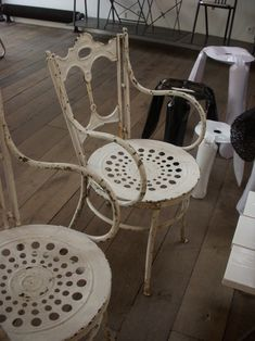 cute french bistro chairs for tables - perhaps with a little pillow for the bum.