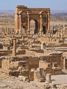 The Arch of Trajan at the Roman Ruins, Timgad, Algeria.  Timgad was a colonial town established around 100 AD by the Emperor Trajan.