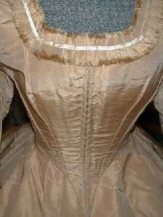 This is an amazing 2 piece cafe au lait colored silk dress from the Civil War Era, perhaps a wedding dress(?).