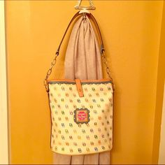 Dooney & Bourke Shoulder Bag Absolutely gorgeous handbag / like-new / colorful signature print / blue interior with lots of storage space and hook for wallet / leather and chain shoulder strap / strap closure / perfect condition Dooney & Bourke Bags Shoulder Bags