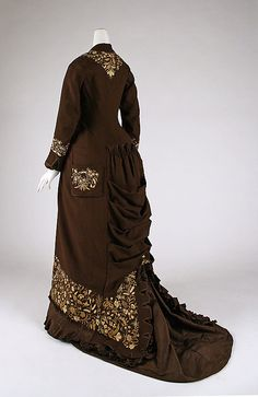 Embroidered brown wool dress with silk ruffles (back), American, 1876-78.