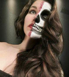 Half skeleton face and half beauty. Halloween idea using face paint.