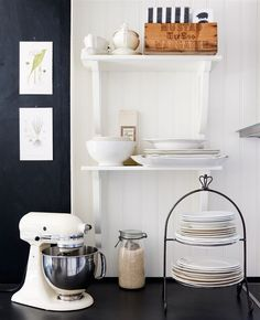 Black and white is a classic combination in a kitchen with clean lines and sleek finishes