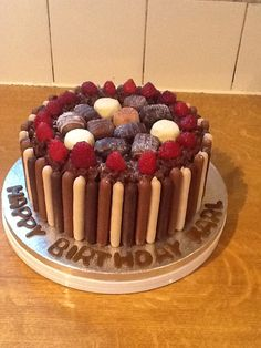 Chocolate birthday cake. I think the toppings could be marshmallows.