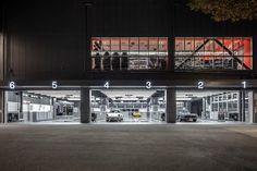 TONERICO:INC designs a two floor automotive emporium for both man and machine in tokyo Car Workshop, Workshop Design, Mechanic Garage, Car Garage, Places That Cater, Tokyo Design, Modern Garage, Custom Garages, Garage Interior