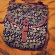 Hobo crossbody purse with elephant print Elephant crossbody purse with pocket in front. Small and gently used. Bags Crossbody Bags