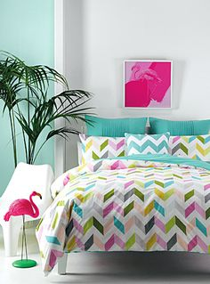 """Linen House at Simons Maison. Trendy chevrons and fashion colours on a white ground, this print on easy-care poly cotton is perfect for an instant bedroom make over. The set includes: Twin: 1 duvet cover 66"""" x 90"""", 1 pillow sham 20"""" x 26"""" Double: 1 duvet cover 84"""" x 90"""", 2 pillow shams 20"""" x 26"""" Queen: 1 duvet cover 90"""" x 95"""", 2 pillow shams 20"""" x 29"""" King: 1 duvet cover 108"""" x 95"""", 2 pillow shams 20"""" x 36"""""""