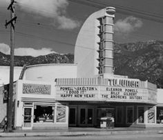 "Exterior view of the Tujunga movie house, 1943. Showing at the theatre was ""I Dood It"" with Eleanor Powell, Red Skelton, Billy Gilbert and the Andrews Sisters. Next door to the theatre on the left is Pop's Fountain Service and on the right is Tujunga Electric. Photographers: The Record-Ledger and Sunland-Tujunga Chamber of Commerce. Donor: The Record-Ledger. Black and white photograph."
