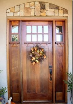 modern stained wood door with sidelights
