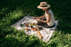 A picnic like this would be so awesome right now! I love the spread she has, too. It looks so fresh and yummy! There's nothing like good food on a picnic!
