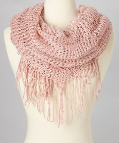 Add a little sparkle to the task of staying cozy. Sequin embellishments give this fringed infinity scarf some standout shimmer, while open-knit acrylic yarn lends softness and style.