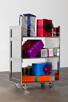 """""""Gift Cart"""", 2011 by Kathryn Andrews. Stainless steel, rented props."""