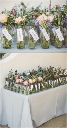 Unique wedding escort card ideas, jars of flowers, white name cards, natural // Anna Delores Photography