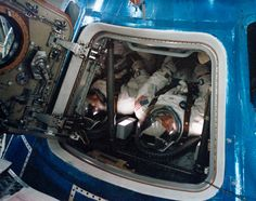 (15 Nov. 1968) — The Apollo 9 prime crew is seen inside the Apollo 9 spacecraft in the Kennedy Space Center's Manned Spacecraft Operations Building during manned altitude chamber test activity. Left to right, are astronauts James A. McDivitt, commander; David R. Scott, command module pilot; and Russell L. Schweickart (out of view to far right), lunar module pilot.