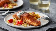 Salmon fillets are lightly seasoned, pan-seared to perfection and served with fresh cool sour cream, lime and cilantro sauce, all done in under 30 minutes.