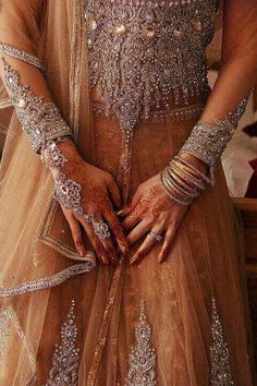 Why not carry jewellery elements onto your wedding dress as seen on this gorgeous Indian bride dress