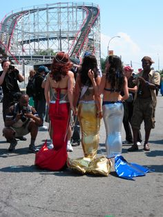 The Cyclone Roller Coaster forms the backdrop to this picture from the Mermaid Parade at Coney Island