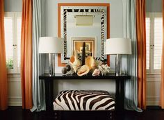 """An idea to consider; mixing the """"in- trend""""look of zebra stripes with coastal accents. Not an easy concept to grasp, but one that can bring real glamour to a beach house!"""