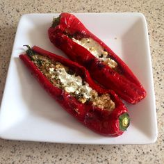 Slimming world red peppers stuffed with cous cous and spinach and topped with Philadelphia light cheese