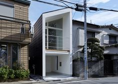 The Japanese architecture firm, Another Apartment, designed this small house on a narrow lot in suburban Tokyo. The house features a glazed façade that pro Japanese Architecture, Modern Architecture, Minimalist Architecture, Koshino House, Casa Park, Mini Loft, Compact House, Narrow House, Tadao Ando