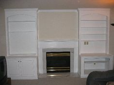 Picture of cabinets and arched bookcases built around a fireplace and ...