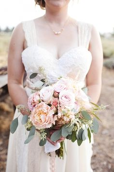 peach and pink bouquet with eucalyptus leaves // photo by SaraLucero.com