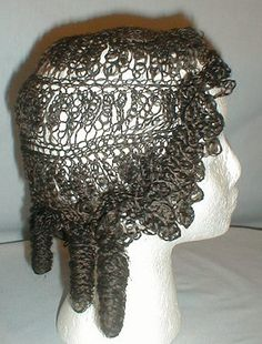 An extremely rare 1850s real hair wig. The full head wig was originally worn by Rosa Perigo Fales. Every bit of this wig is made of real braided hair. The front has small pin curls that frame the face. The back has four large rolled curls.