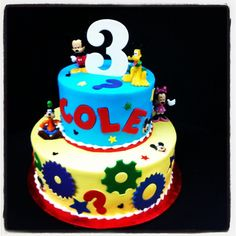 buttercream iced Mickey Mouse clubhouse two tiered cake, fondant gears + stars, Gumpaste name and number
