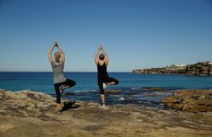 Photo: SYDNEY, AUSTRALIA - JULY 30: Members of the public practise yoga whilst enjoying the warm weather at Bondi Beach on July 30, 2014 in Sydney, Australia. Sydney forecast to hit 23 degrees in the final three days of July, more than six degrees above average. (Photo by Mark Metcalfe/Getty Images) | Bustle