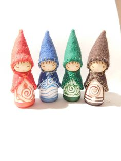 The Four Elements  A Set of Four Wooden Peg dolls Height to tip of hats 10 cm  6 cm Birch wood Peg Dolls Acrylic permanent Winsor & Newton colours Pearl cotton embroidery threads 2 mm Pure virgin wool felts Clear acrylic glaze Non toxic Sealant  Fire Earth Water Air  so snug in their