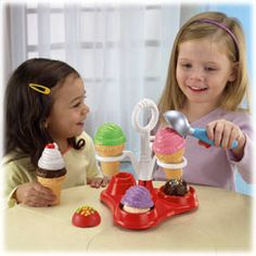 """The Servin' Surprises™ Ice Cream Party Set comes with everything you need to have a sweet celebration – including 6 scoops of ice cream (all different """"flavors""""), 3 ice cream toppers, """"magic"""" ice cream scooper and ice cream caddy with easy-carry han"""