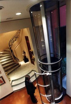 Cheap Home Elevators; This would be possible to use in the center of a spiral staircase.