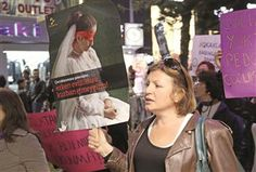 A female protester hold placard that reads 'Do not waste our children's future on early marriages.' AA photo