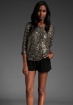 Google Image Result for http://cdna.lystit.com/photos/2011/07/20/vince-gold-cluster-sequin-raglan-shirt-product-1-1168762-801045632_large_flex.jpeg
