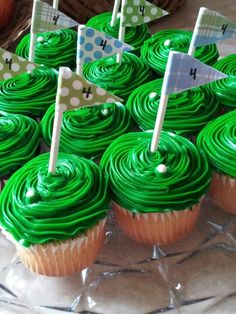 """Tic tac as a golf ball - """"The cupcakes I made for landon's """"FORE"""" birthday par-tee. I used a tic tac as the golf ball and made the flag from scrapbook paper and lollipop sticks."""""""