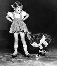 Buster the Rooster ice skates past Cathy Henderson of San Marino.  Photo publshed in the Times Oct. 12, 1952. Credit: Leigh Wiener / Los Angeles Times. S)