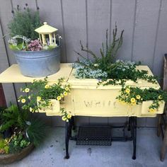 Sewing machine cabinet made into planter.