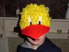 A great idea for an Easter bonnet! Make a chick using an old baseball cap.