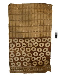 Tunic; two textiles sewn together with whipping stitch; cotton plain weave, slightly warp-dominant; painted after sewing together; one half of tunic (as worn) features 'doughnut' motifs - like large scale resist-dyeing effect - with border of interlocked volutes along bottom edge; other half features rows of feather motifs. Cream, red/brown, dark brown.